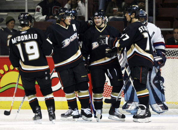 ANAHEIM, CA - SEPTEMBER 22:  (L-R) Andy McDonald, Teemu Selanne, Chris Kunitz and Bruno St. Jacques of the Anaheim Ducks celebrate a goal by Kunitz in the first period against the Vancouver Canucks at the Arrowhead Pond of Anaheim during the preseason gam
