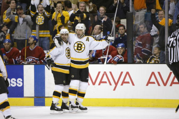 BOSTON, MA - APRIL 21:  Bill Guerin #13 and Don Sweeney #32 of the Boston Bruins celebrate Guerin's goal against the Montreal Canadiens during game two of the Stanley Cup playpoffs at the Fleet Center in Boston, Massachusetts on April 21, 2002. The Bruins