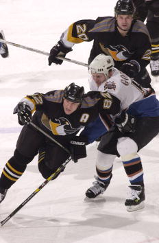 8 Jan 2001:  Martin Straka #82 of the Pittsburgh Penguins is hooked by Sergei Gonchar #55 of the Washington Capitals as Robert Lang #22 of the Penguins follows the play. Straka recorded a hat trick as the Penguins defeated the Capitals 5-3 at the MCI Cent