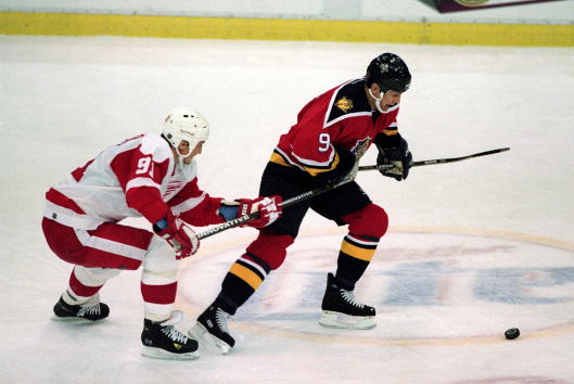 13 Dec 2000:  Igor Larionov #9 of the Florida Panthers tries to steal the puck from Sergei Fedorov #91 of the Detroit Red Wings during the game at the Joe Louis Arena in Detroit, Michigan. The Panthers tied the Red Wings 3-3.Mandatory Credit: Tom Pidgeon/