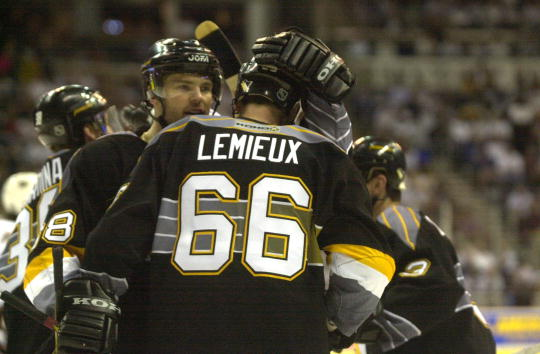 21 Apr 2001 : Jaromir Jagr #68 of the Pittsburgh Penguins hugs his teammate Mario Lemieux after scoring against the Washington Capitals during Game 5 of the Eastern Conference Quarterfinals of the Stanley Cup Playoffs at MCI Center in Washington, DC . The