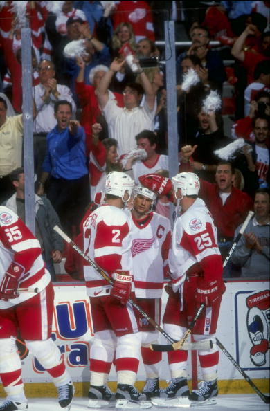 11 Jun 1998:  Steve Yzerman #19, Viacheslav Fetisov #2, and Darren McCarty #25 of the Detroit Red Wings talk during the Stanley Cup Finals game against the Washington Capitals at the Joe Louis Arena in Detroit, Michigan. The Red Wings defeated the Capital