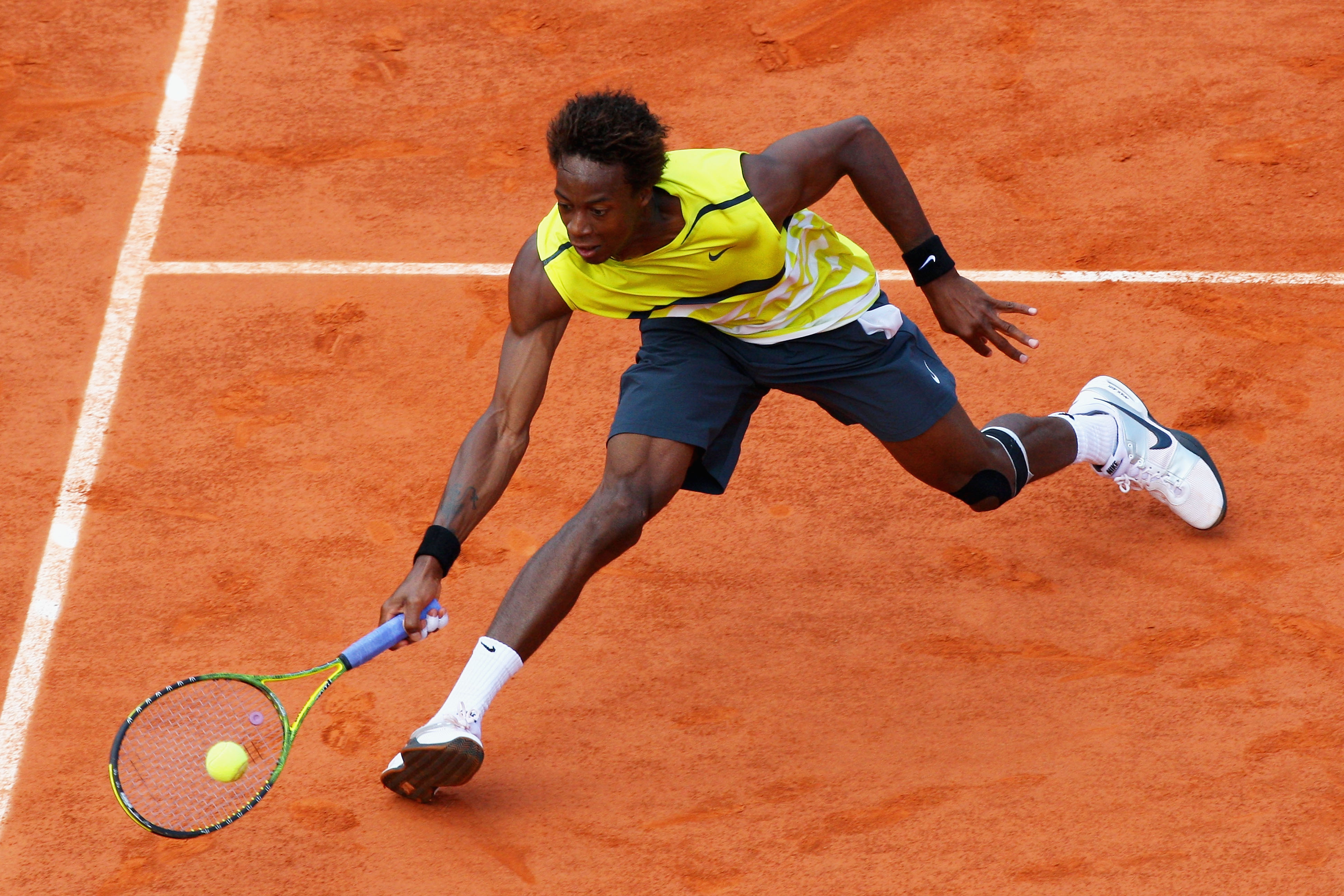 PARIS - JUNE 03:  Gael Monfils of France plays a forehand during the Men's Singles Quarter Final match against Roger Federer of Switzerland on day eleven of the French Open at Roland Garros on June 3, 2009 in Paris, France.  (Photo by Ryan Pierse/Getty Im