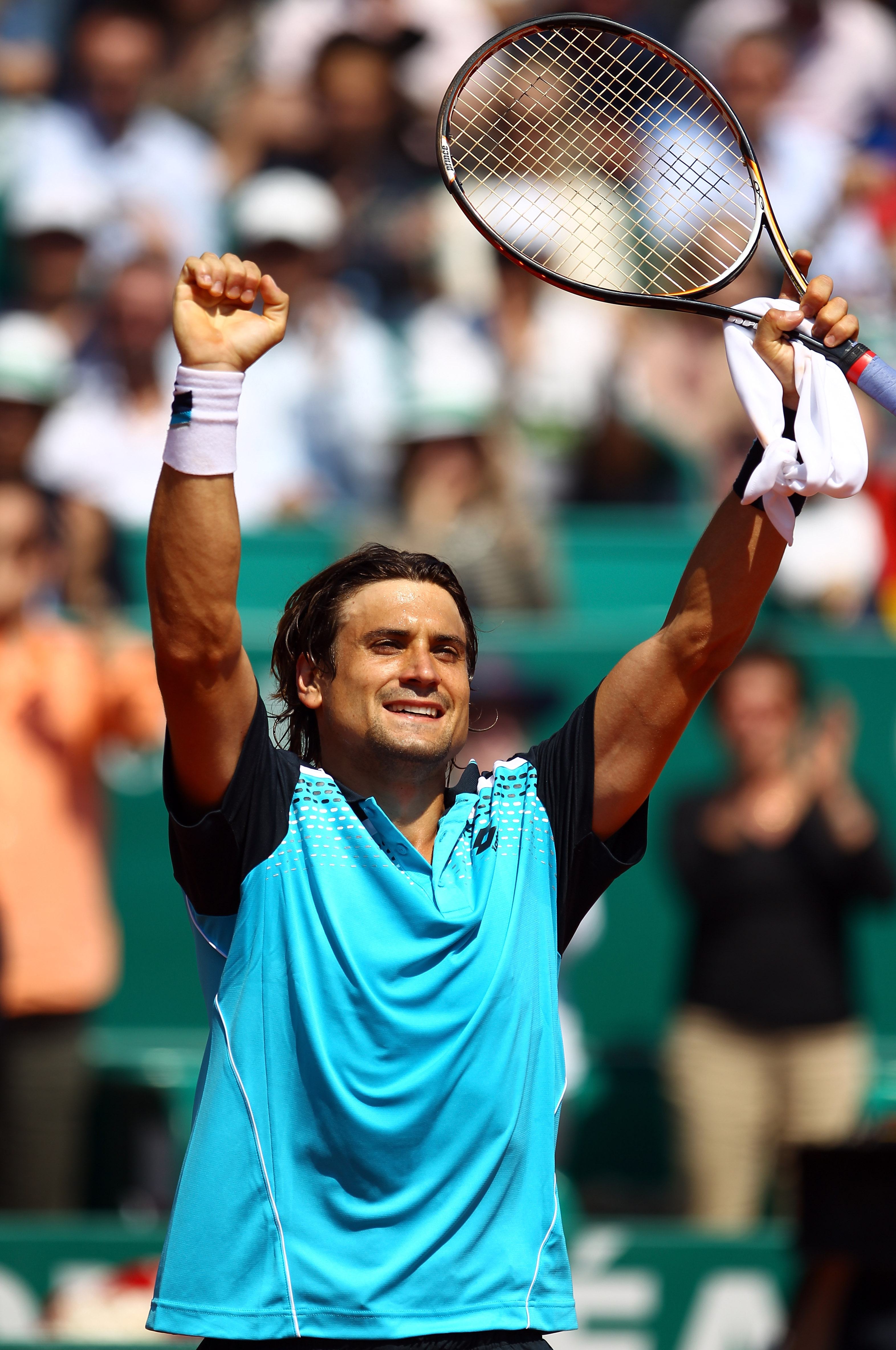 MONACO - APRIL 16:  David Ferrer of Spain celebrates defeating Jurgen Melzer of Austria during Day Seven of the ATP Masters Series Tennis at the Monte Carlo Country Club on April 16, 2011 in Monte Carlo, Monaco.  (Photo by Julian Finney/Getty Images)