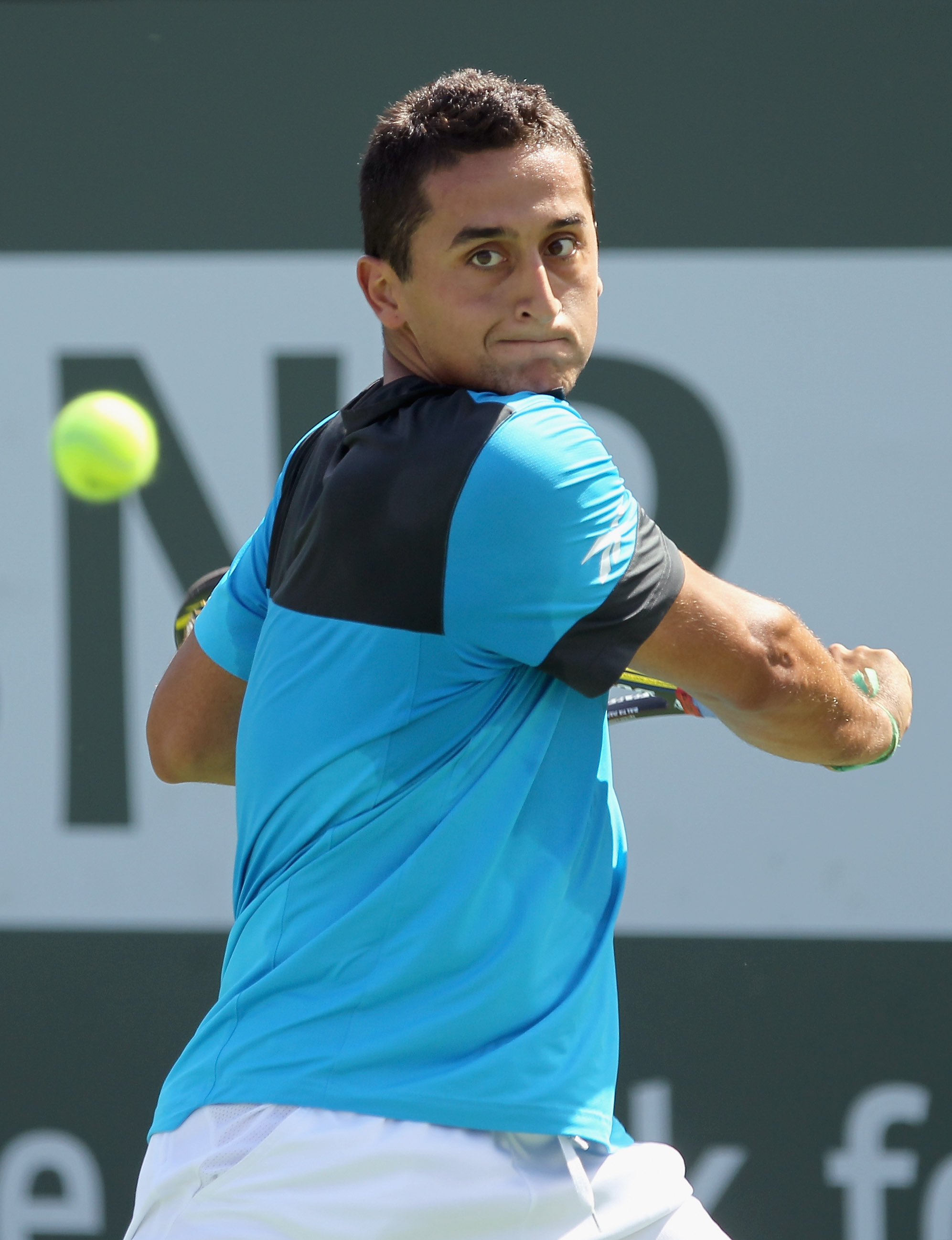 INDIAN WELLS, CA - MARCH 14:  Nicolas Almagro of Spain returns a shot to Albert Montanes of Spain during the BNP Paribas Open at the Indian Wells Tennis Garden on March 14, 2011 in Indian Wells, California.  (Photo by Ezra Shaw/Getty Images)