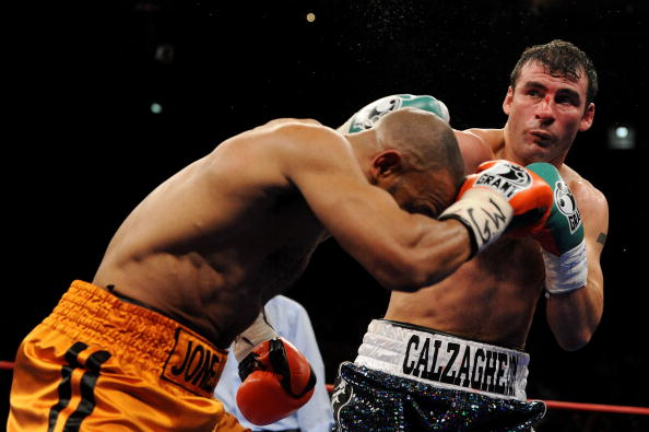 NEW YORK - NOVEMBER 08:  Joe Calzaghe of Wales (R) punches Roy Jones Jr (L) during their Ring Magazine Light Heavyweight Championship bout at Madison Square Garden November 8, 2008 in New York City.  (Photo by Al Bello/Getty Images)
