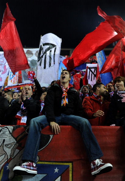 MADRID, SPAIN - JANUARY 20:  Atletico Madrid fans cheer prior to the start of the quarter-final Copa del Rey second leg match between Atletico Madrid and Real Madrid and at Vicente Calderon Stadium on January 20, 2011 in Madrid, Spain.  (Photo by Jasper J