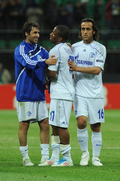 MILAN, ITALY - APRIL 05:  Raul (L), Jefferson Farfan (C) and Ali Karimi of Schalke 04 celebrate victory at the end of the UEFA Champions League Quarter Final match between FC Internazionale Milano and Schalke 04 at San Siro Stadium on April 5, 2011 in Mil