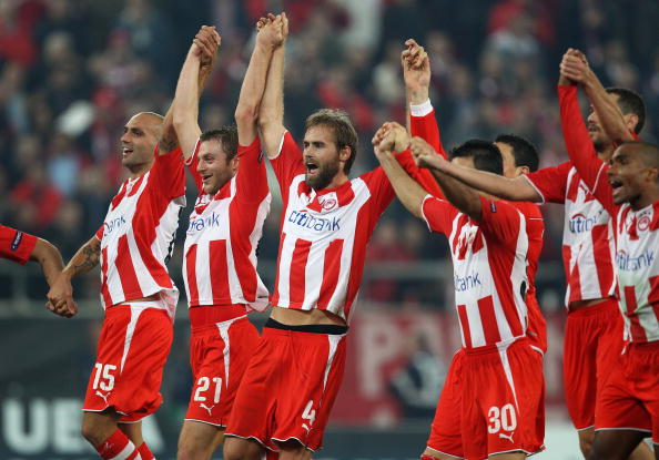 ATHENS, GREECE - DECEMBER 09:  Olympiakos players celebrate victory at the final whistle during the UEFA Champions League Group H match between Olympiakos and Arsenal at the Georgios Karaiskakis Stadium on December 9, 2009 in Athens, Greece.  (Photo by Ri
