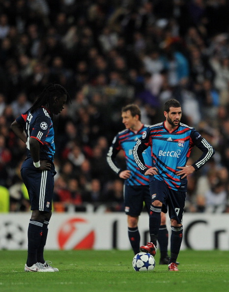 MADRID, SPAIN - MARCH 16:  Bafetimbi Gomis (L) and Lisandro (R) of Lyon stand dejected after conceding a goal during the UEFA Champions League round of 16 second leg match between Real Madrid and Lyon at Estadio Santiago Bernabeu on March 16, 2011 in Madr