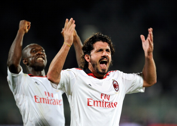 FLORENCE, ITALY - APRIL 10:  Clarence Seedorf and Gennaro Gattuso of AC Milan celebrates during the Serie A match between ACF Fiorentina and AC Milan at Stadio Artemio Franchi on April 10, 2011 in Florence, Italy.  (Photo by Claudio Villa/Getty Images)