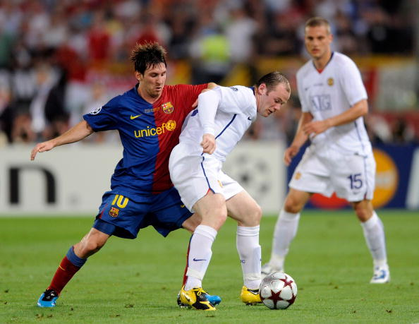 ROME, ITALY - MAY 27:  Wayne Rooney (R) of Manchester United FC is challenged by Lionel Messi of Barcelona during the UEFA Champions League Final match between Barcelona and Manchester United at the Stadio Olimpico on May 27, 2009 in Rome, Italy.  (Photo