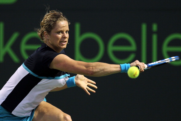 KEY BISCAYNE, FL - MARCH 30:  Kim Clijsters of Belgium stretches for a backhand return against Victoria Azarenka of Belarus during the Sony Ericsson Open at Crandon Park Tennis Center on March 30, 2011 in Key Biscayne, Florida.  (Photo by Al Bello/Getty I
