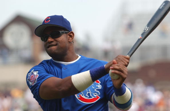 CHICAGO - JUNE 18:  Sammy Sosa #21of the Chicago Cubs  swings during practice before the interleague game against the Oakland Athletics on June 18, 2004 at Wrigley Field in Chicago, Illinois. The A's defeated the Cubs 2-1. (Photo by Jonathan Daniel/Getty