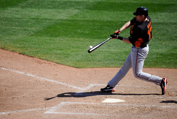 PEORIA, AZ - MARCH 08: Aubrey Huff #17 of the San Francisco Giants hits a deep fly out against Seattle Marinerr during the spring training baseball game against at Peoria Stadium on March 8, 2011 in Peoria, Arizona.  (Photo by Kevork Djansezian/Getty Imag