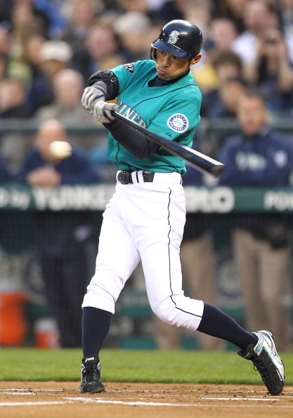 SEATTLE - APRIL 08:  Ichiro Suzuki #51 of the Seattle Mariners singles in the first inning against the Cleveland Indians during the Mariners' home opener at Safeco Field on April 8, 2011 in Seattle, Washington. (Photo by Otto Greule Jr/Getty Images)