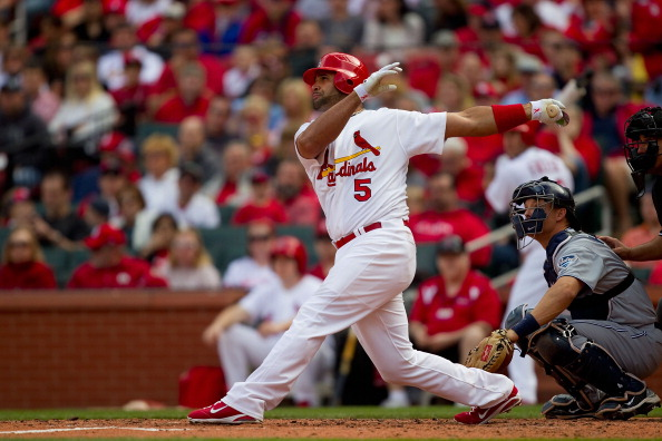 ST. LOUIS, MO - APRIL 2: Albert Pujols #5 of the St. Louis Cardinals hits a solo home run against the San Diego Padres at Busch Stadium on April 2, 2011 in St. Louis, Missouri.  (Photo by Dilip Vishwanat/Getty Images)