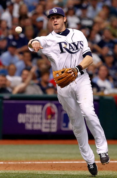 ST. PETERSBURG, FL - OCTOBER 06:  Infielder Evan Longoria #3 of the Tampa Bay Rays throws over to first for an out against the Texas Rangers during Game 1 of the ALDS at Tropicana Field on October 6, 2010 in St. Petersburg, Florida.  (Photo by J. Meric/Ge