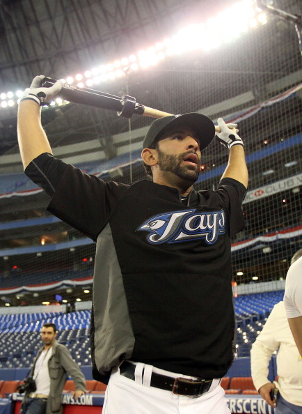 TORONTO,CANADA - APRIL 1:  Jose Bautista #19 of the Toronto Blue Jays stretches prior to the home opener for the Toronto Blue Jays as they face the Minnesota Twins during their MLB game at the Rogers Centre April 1, 2011 in Toronto, Ontario, Canada.(Photo