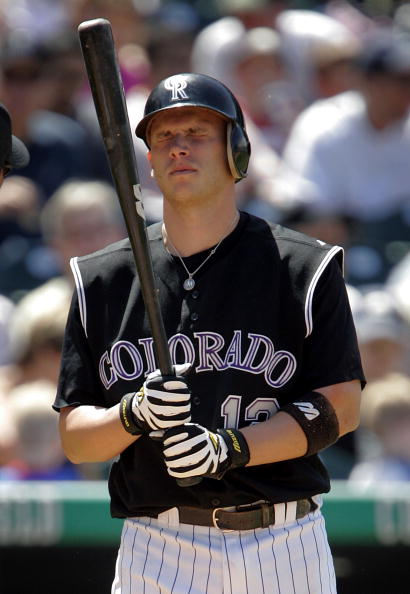 DENVER - MAY 15:  Clint Barmes #12 of the Colorado Rockies grimaces after fouling a pitch off himself against the Arizona Diamondbacks on May 15, 2005 at Coors Field in Denver, Colorado. The D-backs defeated the Rockies 5-4.  (Photo by Brian Bahr/Getty Im