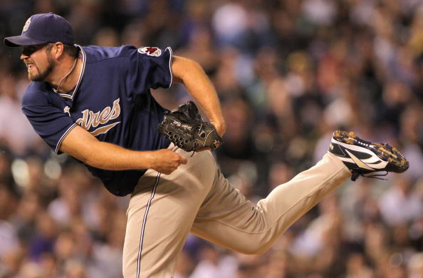 DENVER - SEPTEMBER 13:  Relief pitcher Heath Bell #21 of the San Diego Padres delivers against the Colorado Rockies at Coors Field on September 13, 2010 in Denver, Colorado. Bell recorded a save as the Padres defeated the Rockies 6-4.  (Photo by Doug Pens