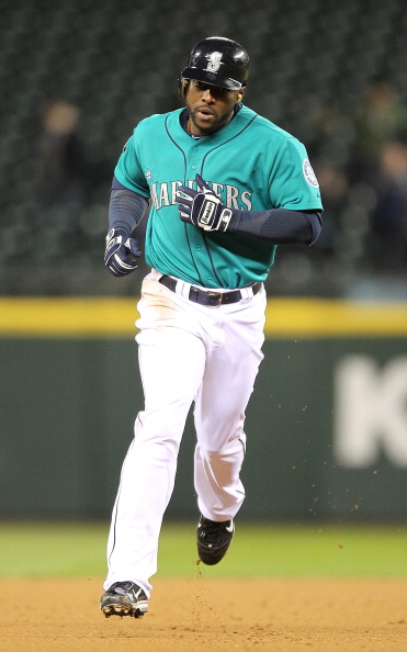 SEATTLE - APRIL 11:  Milton Bradley #15 of the Seattle Mariners rounds the bases after homering against the Toronto Blue Jays at Safeco Field on April 11, 2011 in Seattle, Washington. (Photo by Otto Greule Jr/Getty Images)