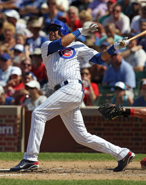 CHICAGO - JULY 16: Aramis Ramirez #16 of the Chicago Cubs hits the game-winning home run, a solo shot in the 8th inning, against the Philadelphia Phillies at Wrigley Field on July 16, 2010 in Chicago, Illinois. The Cubs defeated the Phillies 4-3. (Photo b
