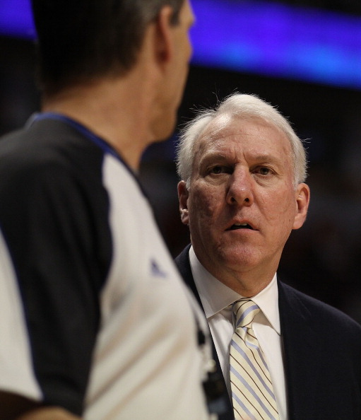 CHICAGO, IL - FEBRUARY 17: Head coach Gregg Popovich of the San Antonio Spurs talks with a referee during a game against the Chicago Bulls at the United Center on February 17, 2011 in Chicago, Illinois. The Bulls defeated the Spurs 109-99. NOTE TO USER: U