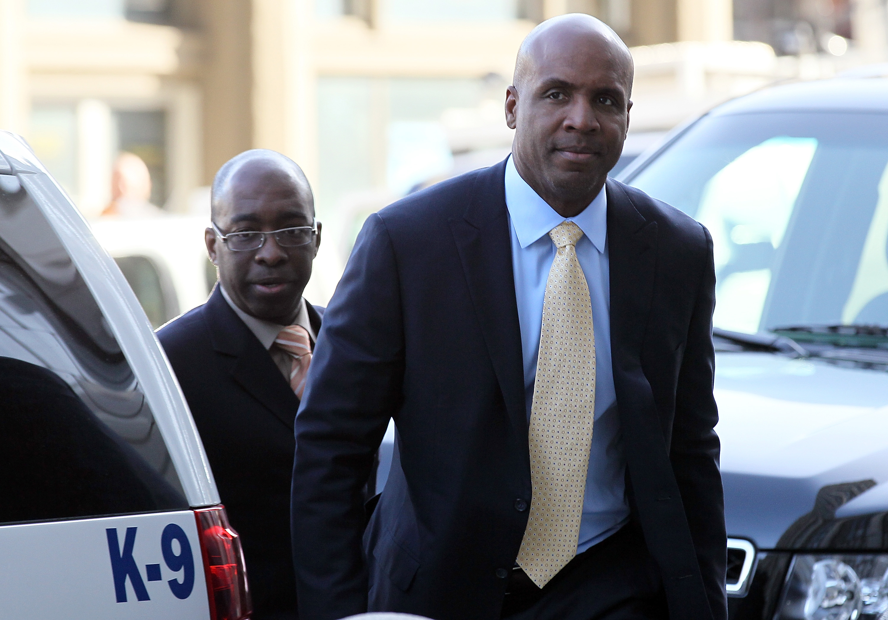 SAN FRANCISCO, CA - APRIL 12:  Former Major League Baseball player Barry Bonds (R) arrives at federal court on April 12, 2011 in San Francisco, California.  The jury is deliberating for the third day in the Barry Bonds perjury trial where the former baseb