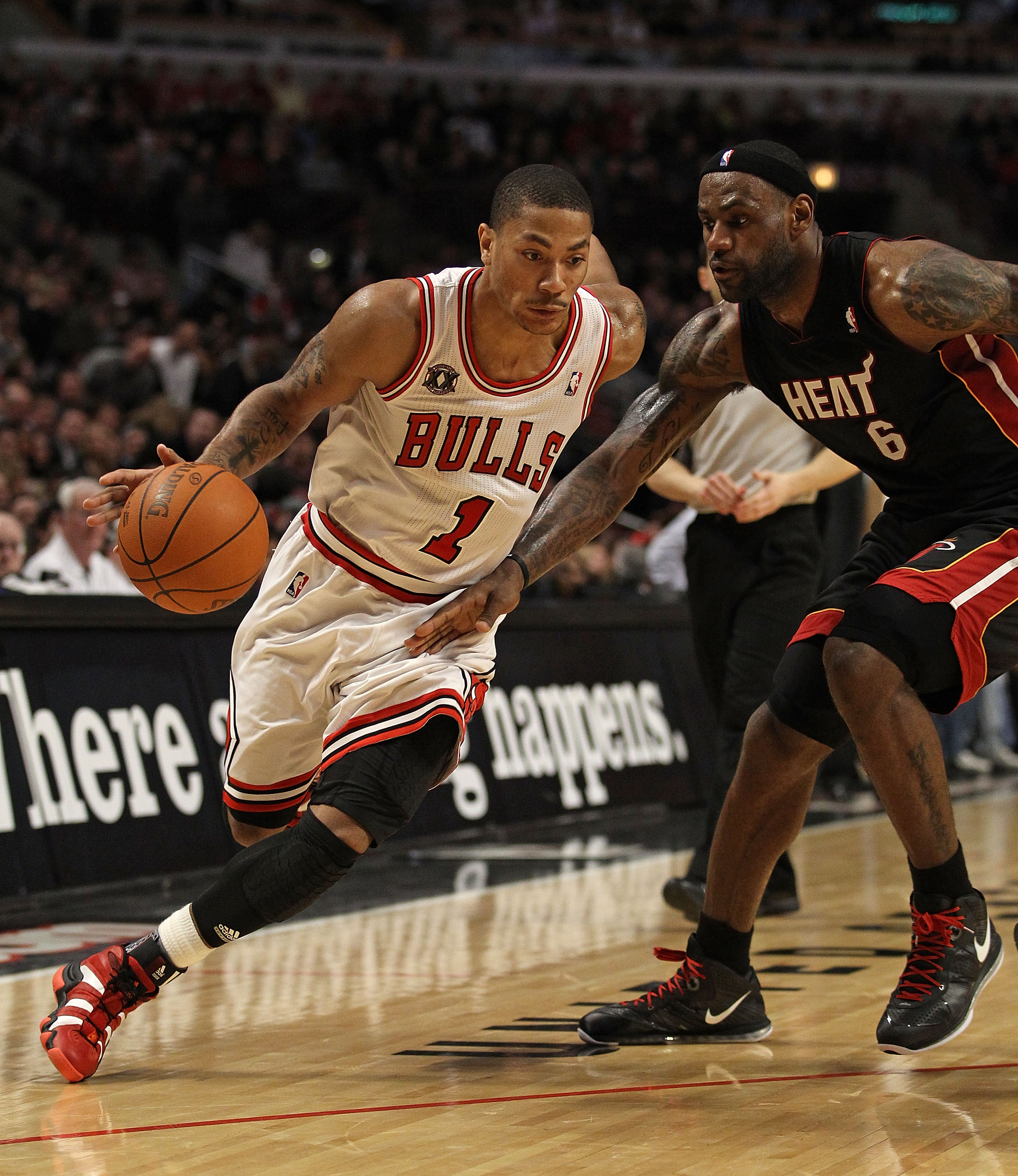 CHICAGO, IL - FEBRUARY 24: Derrick Rose #1 of the Chicago Bulls drives against LeBron James #6 of the Miami Heat at the United Center on February 24, 2011 in Chicago, Illinois. The Bulls defeated the Heat 93-89. NOTE TO USER: User expressly acknowledges a