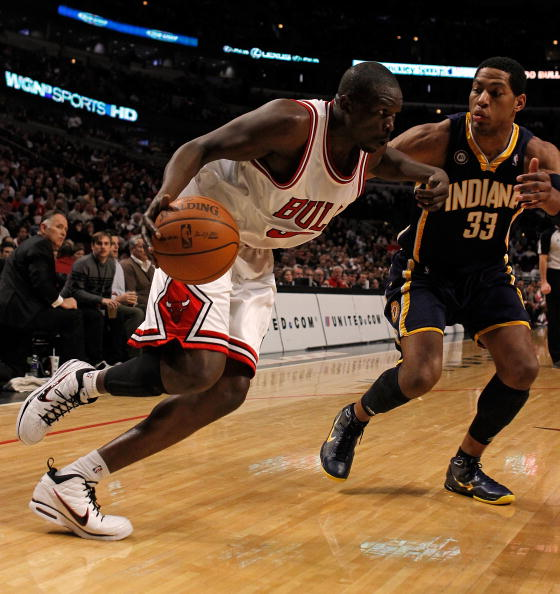 CHICAGO - FEBRUARY 24: Loul Deng #9 of the Chicago Bulls drives against Danny Granger #33 of the Indiana Pacers at the United Center on February 24, 2010 in Chicago, Illinois. The Bulls defeated the Pacers 120-110. NOTE TO USER: User expressly acknowledge