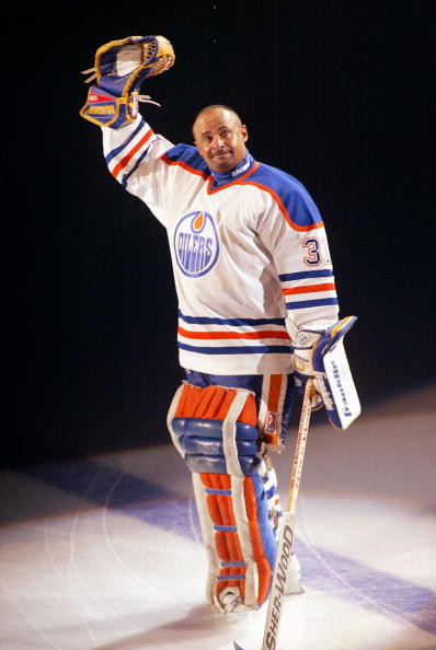 EDMONTON, CANADA - OCTOBER 9:  Hall of Fame goalie Grant Fuhr #31 of the Edmonton Oilers waves to the crowd during his number retirement ceremony at the Skyreach Center October 9, 2003 in Edmonton, Alberta, Canada.  (Photo by Ian Tomlinson/Getty Images)