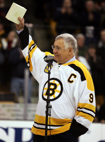 BOSTON - FEBRUARY 13:  John 'the Chief' Bucyk waves to the crowd during a ceremony to honor his fifty years with the Boston Bruins organization before the game between the Edmonton Oilers and the Boston Bruins on February 13, 2007 at the TD Banknorth Gard
