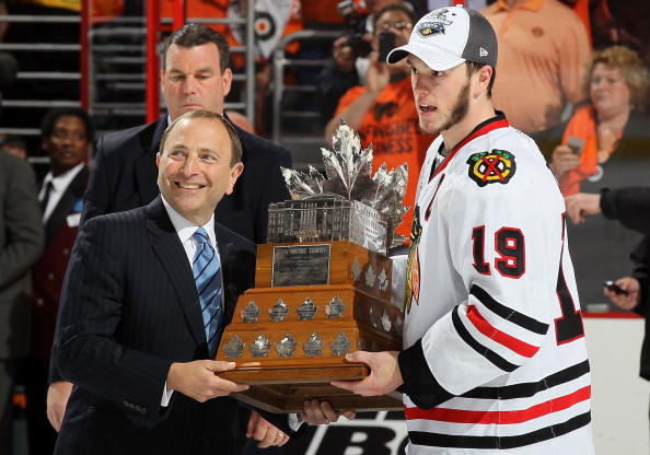 PHILADELPHIA - JUNE 09: NHL Commissioner Gary Bettman presents Jonathan Toews #19 of the Chicago Blackhawks with the Conn Smythe Trophy after teammate Patrick Kane scored the game-winning goal in overtime to defeat the Philadelphia Flyers 4-3 and win the