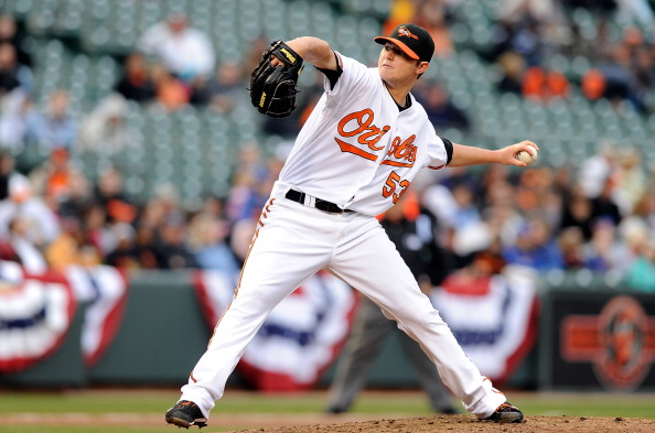 BALTIMORE, MD - APRIL 09:  Zach Britton #53 of the Baltimore Orioles pitches against the Texas Rangers at Oriole Park at Camden Yards on April 9, 2011 in Baltimore, Maryland.  (Photo by Greg Fiume/Getty Images)