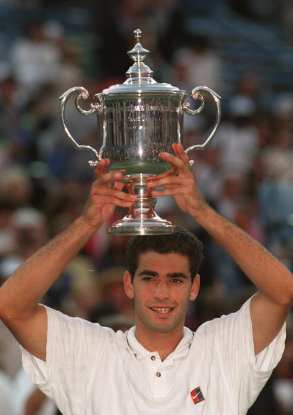 10 Sep 1995: PETE SAMPRAS OF THE USA HOLDS UP THE TROPHY AS HE REJOICES AT HIS VICTORY AGAINST ANDRE AGASSI IN THE FINAL OF THE MENS SINGLES AT THE US OPEN IN FLUSHING MEADOW, NEW YORK, UNITED STATES.