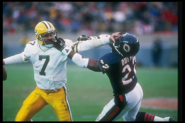 27 Nov 1988:  Quarterback Don Majkowski of the Green Bay Packers (left) attempts to evade Chicago Bears defensive back Dave Duerson during a game at Soldier Field in Chicago, Illinois.  The Bears won the game, 16-0. Mandatory Credit: Jonathan Daniel  /All