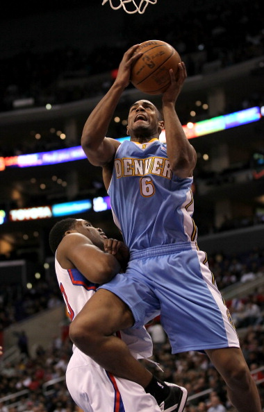 LOS ANGELES, CA - JANUARY 05:  Arron Afflalo #6 of the Denver Nuggets shoots over Ike Diogu #50 of the Los Angeles Clippers at Staples Center on January 5, 2011  in Los Angeles, California.  The Clippers won 106-93.  NOTE TO USER: User expressly acknowled