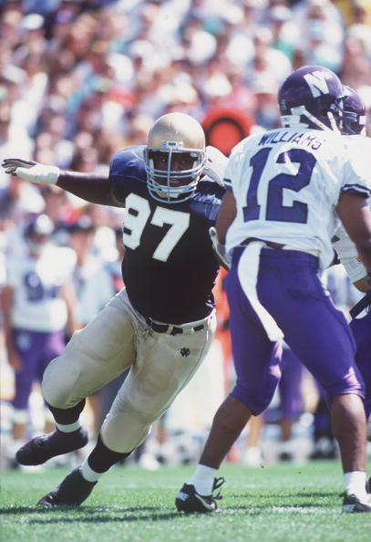 4 Sep 1993: NOTRE DAME DEFENSIVE LINEMAN BRYANT YOUNG DRIVES AOUND THE NORTHWESTERN OFFENSIVE LINE DURING THE IRISH'S VICTORY OVER THE WILDCATS.