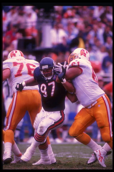 4 Sep 1994: Defensive tackle Chris Zorich of the Chicago Bears (center) works against a Tampa Bay Buccaneers player during a game at Soldier Field in Chicago, Illinois. The Bears won the game, 21-9.