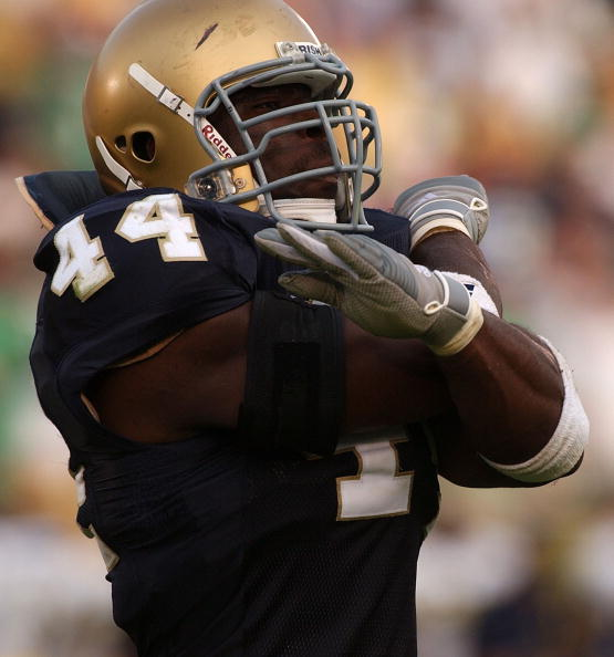 SOUTH BEND, IN - SEPTEMBER 11: Justin Tuck #44 of Notre Dame celebrates after stopping Michigan on third down in the fourth quarter of a game on September 11, 2004 at Notre Dame Stadium in South Bend, Indiana. Notre Dame defeated Michigan 28-20. (Photo by