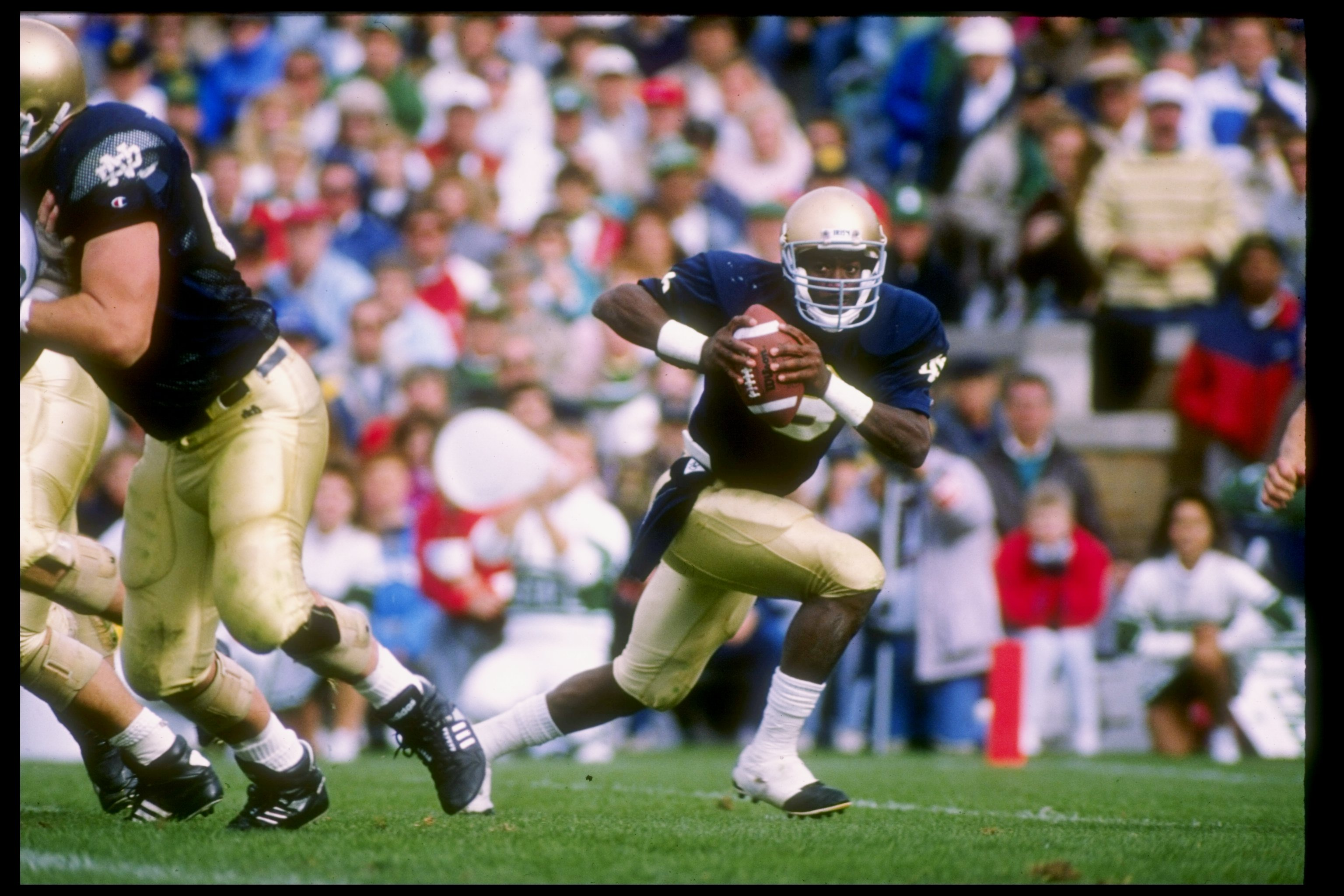 23 Sep 1989:  Quarterback Tony Rice of the Notre Dame Fighting Irish rolls out of the pocket during a game against the Michigan State Spartans at Notre Dame Stadium in South Bend, Indiana.  Notre Dame won the game 21-13. Mandatory Credit: Jonathan Daniel