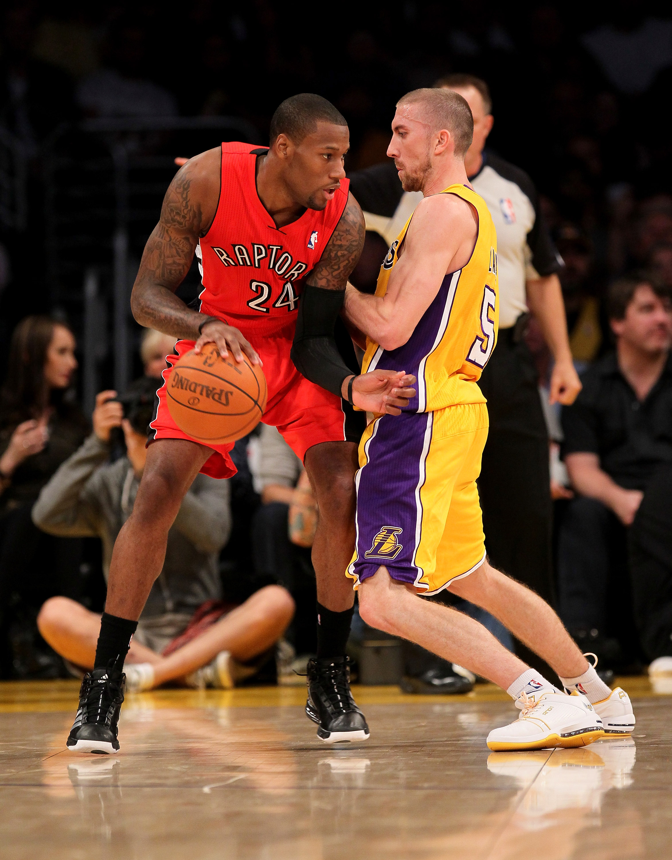 LOS ANGELES - NOVEMBER 5:  Sonny Weims #24 of the Toronto Raptors controls the ball against Steve Blake #5 of the Los Angeles Lakers at Staples Center on November 5, 2010 in Los Angeles, California.   NOTE TO USER: User expressly acknowledges and agrees t