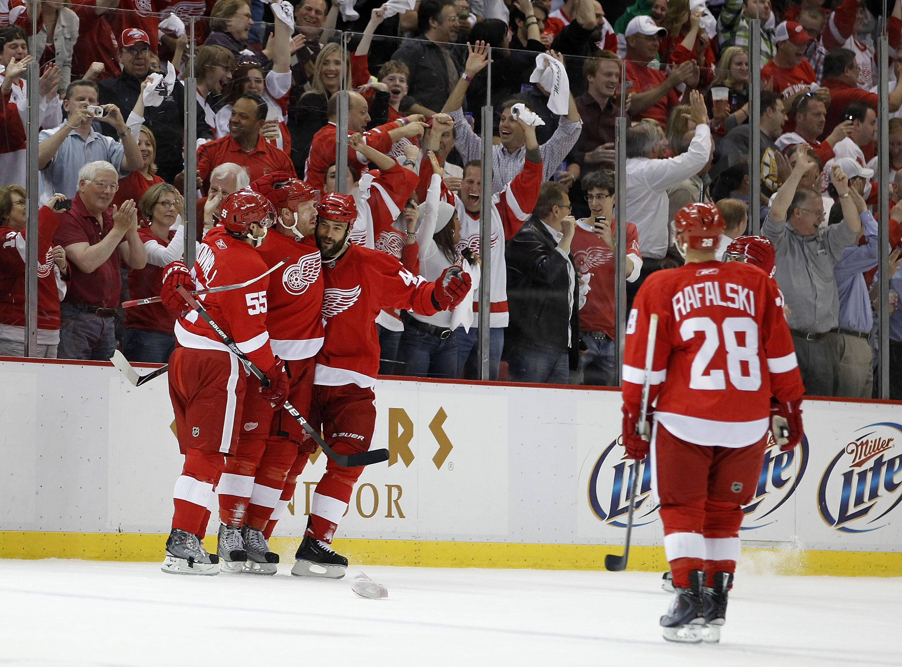 DETROIT - MAY 06: Johan Franzen #93 of the Detroit Red Wings celebrates his third goal of the first period with Niklas Kronwall #55, Todd Bertuzzi #44 and Brian Rafalski #28 while playing the San Jose Sharks in Game Four of the Western Conference Semifina