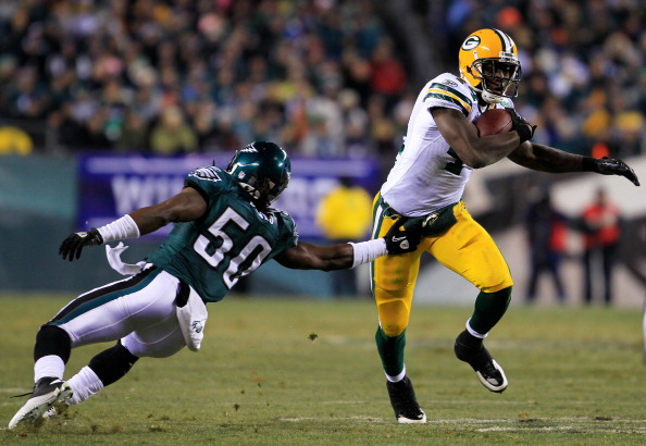 PHILADELPHIA, PA - JANUARY 09:  James Starks #44 of the Green Bay Packers avoids the tackle of Ernie Sims #50 of the Philadelphia Eagles during the 2011 NFC wild card playoff game at Lincoln Financial Field on January 9, 2011 in Philadelphia, Pennsylvania