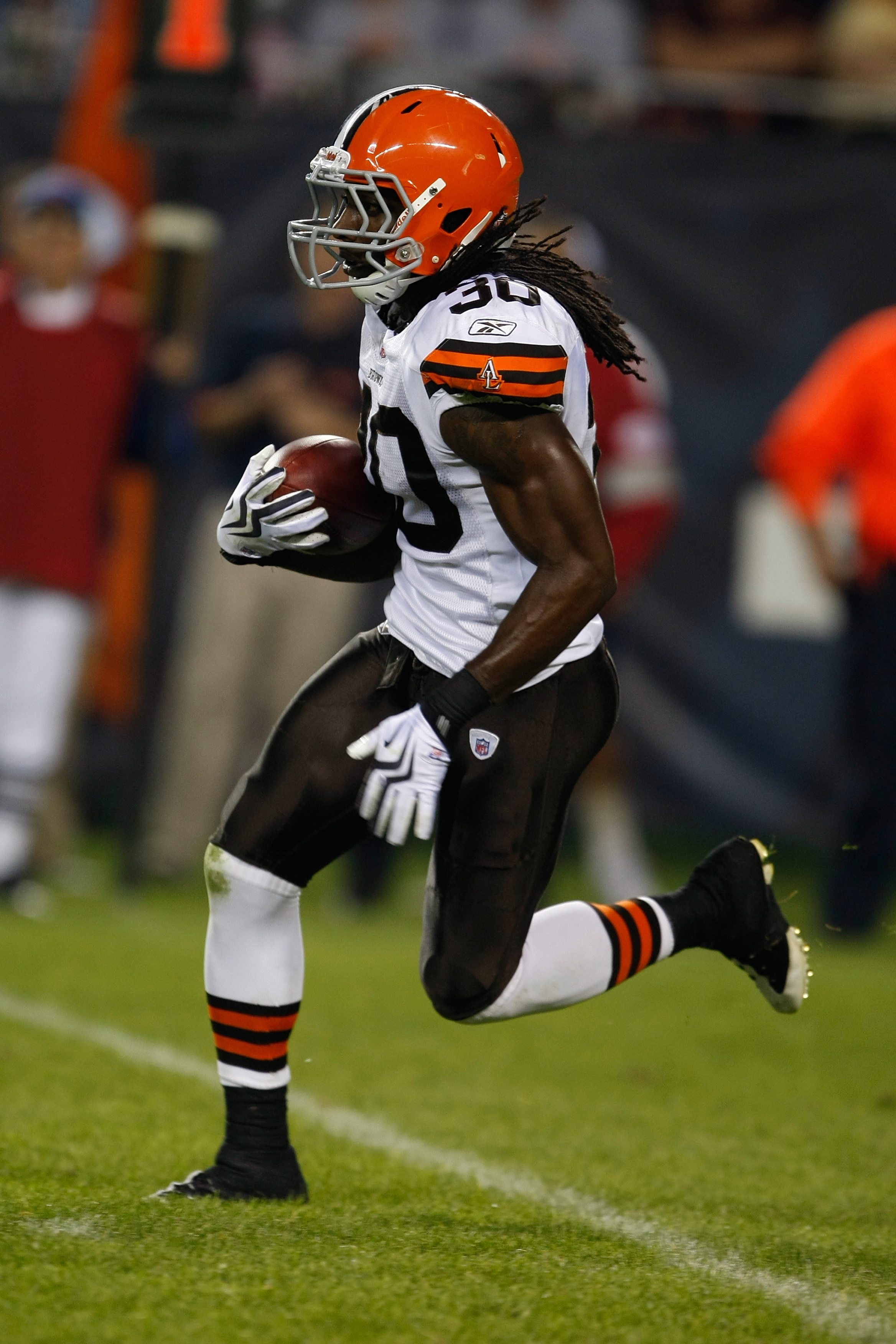 CHICAGO, IL - SEPTEMBER 3: Defensive back Gerald Lawson #30 of the Cleveland Browns runs with the football against  the Chicago Bears at Soldier Field on September 3, 2009 in Chicago, Illinois. The Bears defeated the Browns 26-23. (Photo by Scott Boehm/Ge