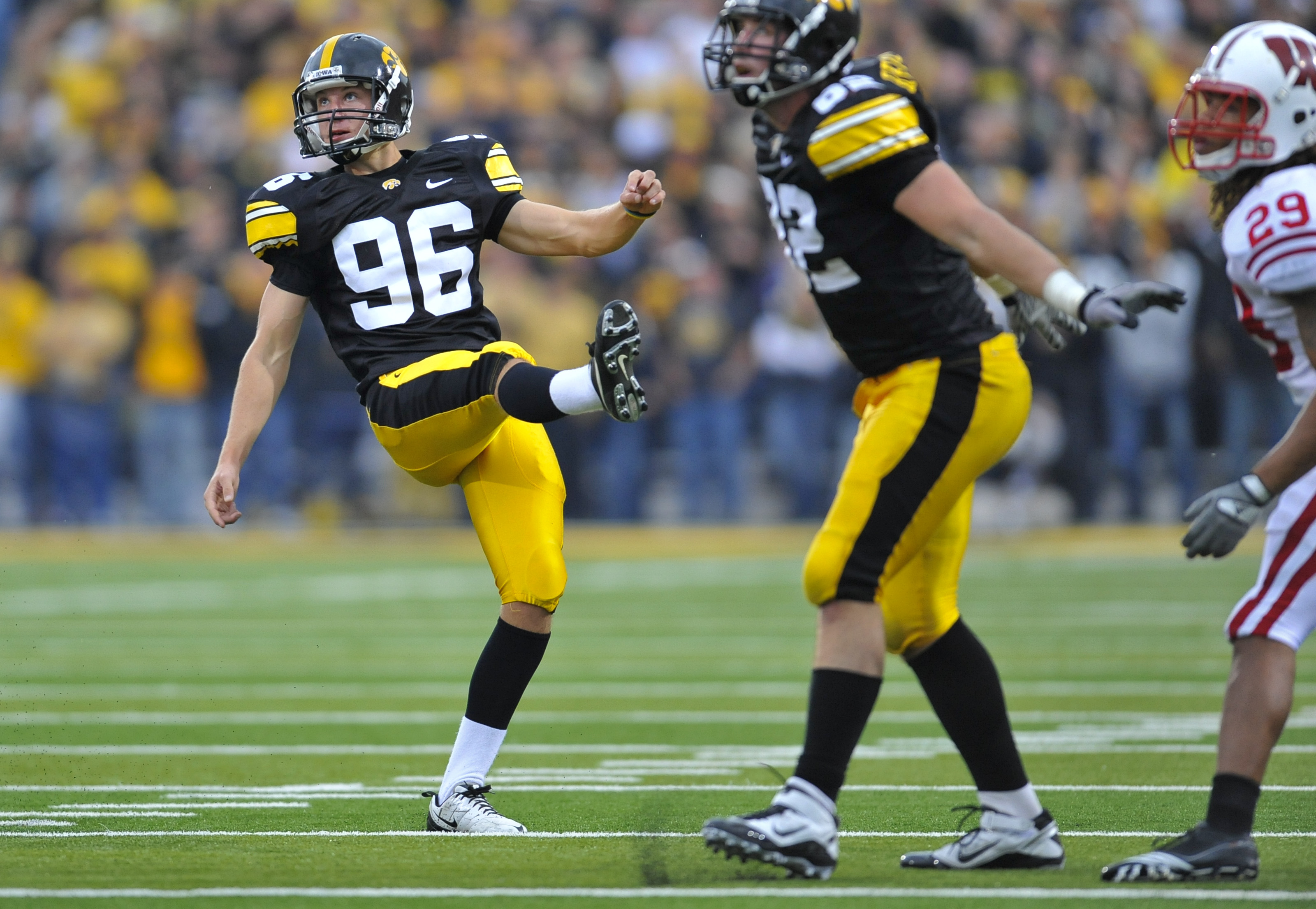 IOWA CITY, IA - OCTOBER 23- Kicker Mike Meyer #96 of the University of Iowa Hawkeyes watches his kick go through the uprights to score a field goal against the Wisconsin Badgers during the second half of play at Kinnick Stadium on October 23, 2010 in Iowa