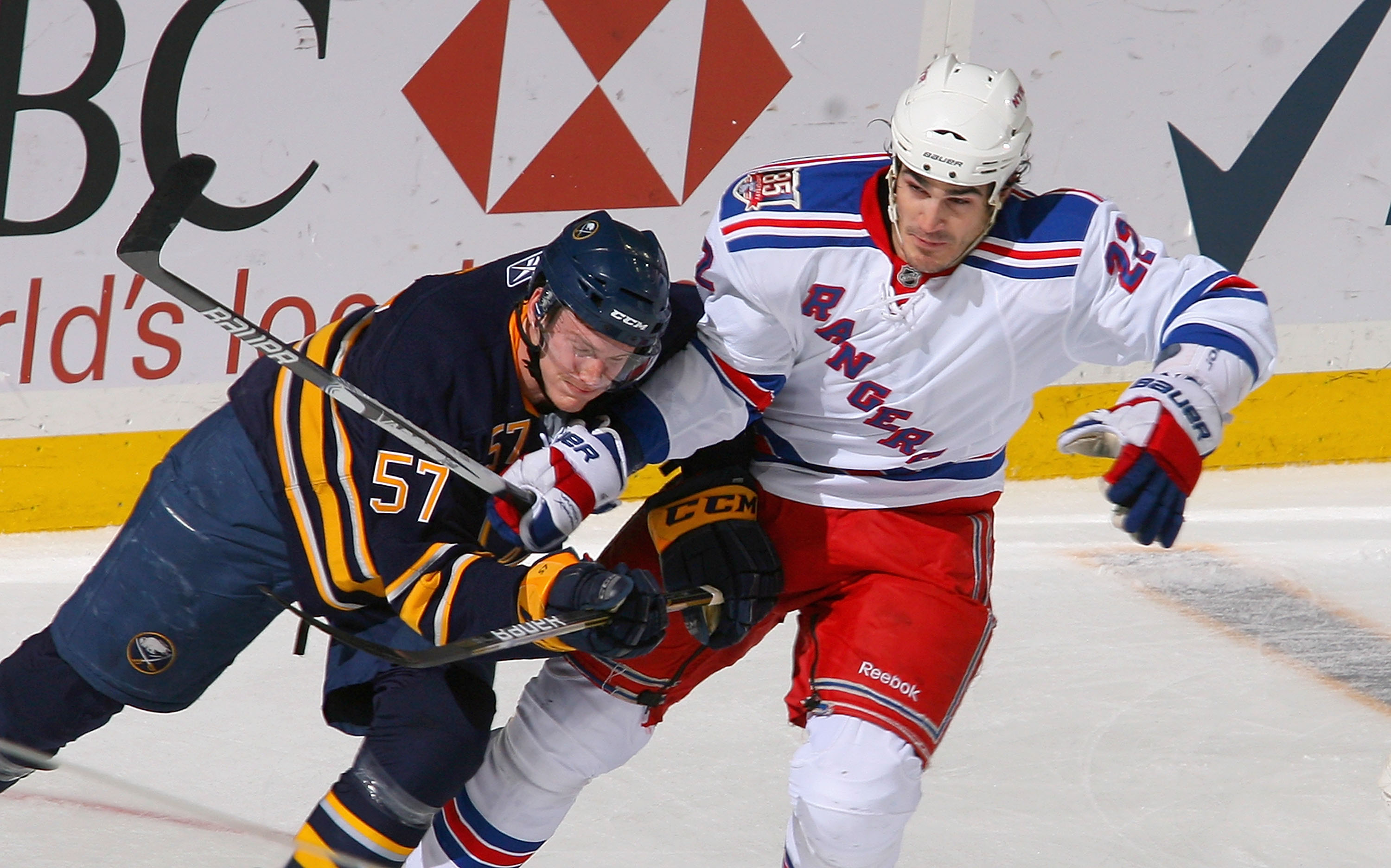 BUFFALO, NY - MARCH 30: Tyler Myers #57 of the Buffalo Sabres skates against Brian Boyle #22 of the New York Rangers at HSBC Arena on March 30, 2011 in Buffalo, New York.  (Photo by Rick Stewart/Getty Images)
