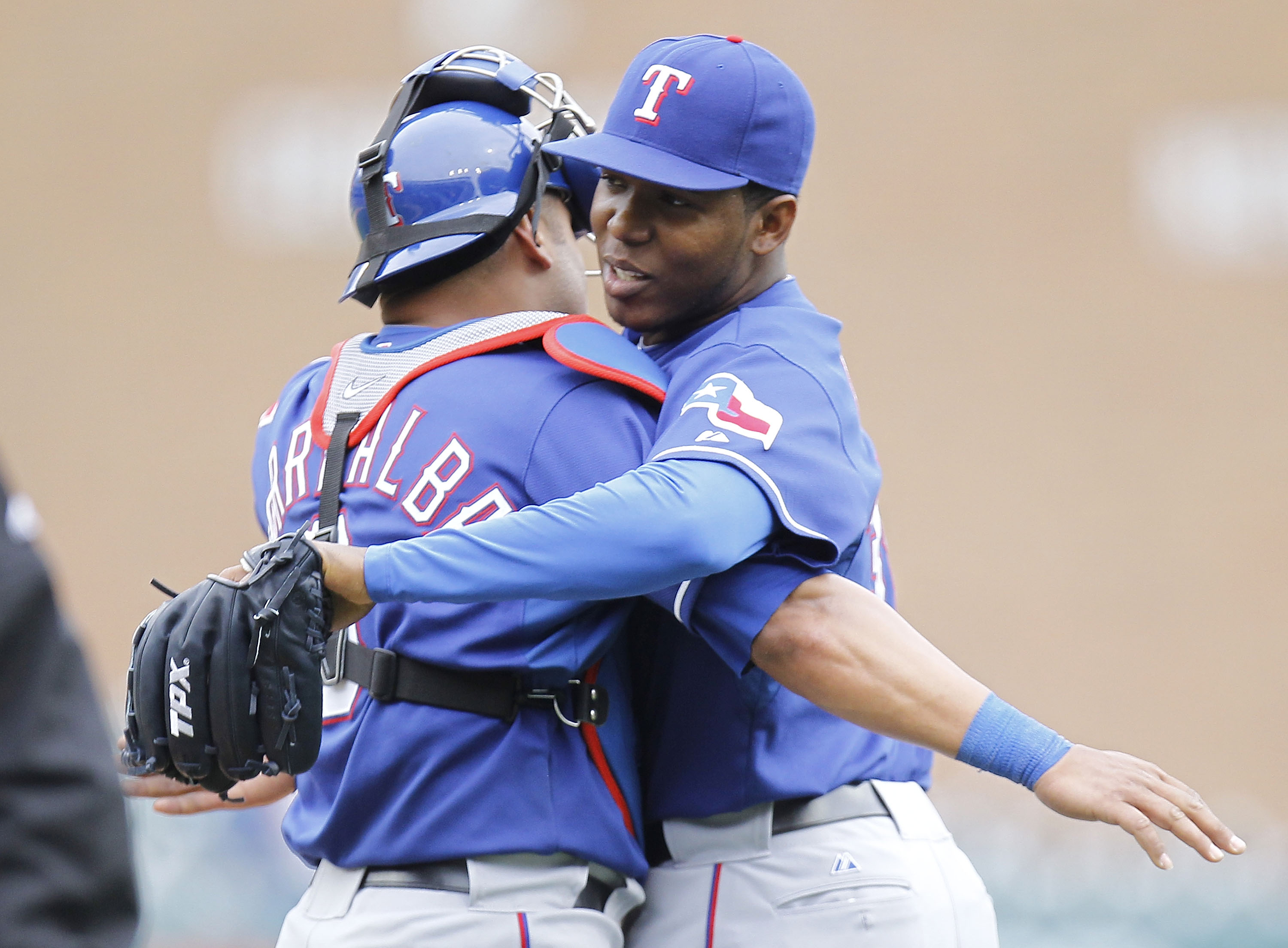 DETROIT, MI - APRIL 11:  Neftali Feliz #30 of the Texas Rangers celebrates a 2-0 win over the Detroit Tigers with Yorvit Torrealba #8 at Comerica Park on April 11, 2011 in Detroit, Michigan.  (Photo by Gregory Shamus/Getty Images)