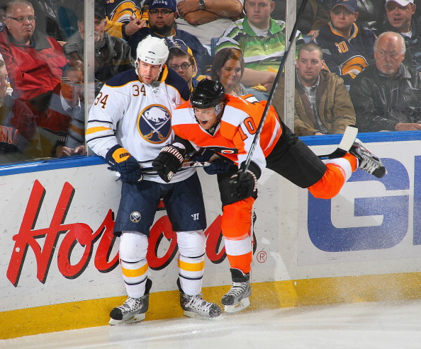 BUFFALO, NY - APRIL 08: Chris Butler #34  of the Buffalo Sabres collides with Kris Versteeg #10 of the Philadelphia Flyers at HSBC Arena on April 8, 2011 in Buffalo, New York.  (Photo by Rick Stewart/Getty Images)